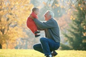 grandfather lifting child in autumn landscape1.JPG